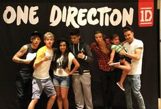 One Direction! Liam's holding the baby!