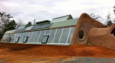 n Earthship is a type of passive solar home made of natural and recycled materials. Designed and marketed by Earthship Biotecture of Taos, NM, the homes are primarily constructed to work autonomously and are generally made of earth-filled tires, utilising thermal mass construction to naturally regulate indoor temperature.