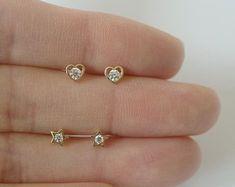 Simple design, Minimalist jewelry shop by tinytinygold Gold Earrings For Kids, Kids Earrings, Small Earrings, Gold Ring Designs, Gold Earrings Designs, Gold Jewellery Design, Cute Stud Earrings, Baby Earrings, Jewelry Shop