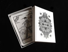 The Efflorescent Tarot Deck: Black and White Cards by efflorescenttarot on Etsy https://www.etsy.com/listing/115608026/the-efflorescent-tarot-deck-black-and