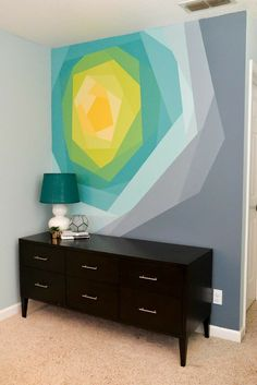 Painted Flower Wall Mural Artwork Painted Flower Wall Mural Artwork All it takes to make this gorgeous flower wall mural is paint, FrogTape, and patience! A stunning addition to any space. Geometric Wall Paint, Diy Wall Painting, Painted Wall Murals, Creative Wall Painting, Painting Doors, Space Painting, Mural Wall Art, Encaustic Painting, Painting Canvas