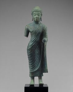 Full size image Original Museum Website Features robe over one shoulder urna as dot Date: 7th–8th century Culture: Indonesia (Kalimantan) Medium: Bronze Dimensions: H. 10 1/2 in. (26.7 cm); W. 3 /1…