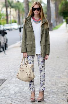 Layer a long-sleeved white shirt under a utility jacket, offsetting them both with artfully printed pants and a bold, bright necklace.