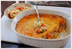 Town and Country Living: Easy Vegetable Gratin - used purple cabbage instead of green, added a bunch of spices to the mashed potatoes. Turned out delicious! Vegetable Gratin Recipes, Veggie Recipes Healthy, Vegetable Dishes, Vegetarian Recipes, Cooking Recipes, Vegetarian Cooking, Potato Recipes, Great Recipes, Favorite Recipes