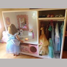 Dress-up cupboard closet entertainment center upcycled With locker chandelier