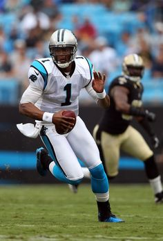 Cam Newton #1 of the Carolina Panthers runs with the ball during their game against the New Orleans Saints at Bank of America Stadium on September 16, 2012 in Charlotte, North Carolina.