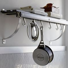 Crate and Barrel Pot Rack - Will hold my cook books as well and save so much room in my drawers!