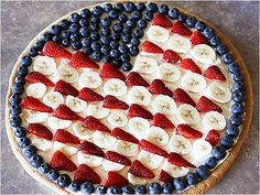 "COOKIE PIZZA - We're sure our forefathers would have happily dug into this dessert, even with the pizza flag's nontraditional blueberry ""star"" border! Blogger Sabby in Suburbia used refrigerated cookie dough, cream cheese, powdered sugar and whipped topping to make the sugary treat: Recipes: American Flag Themed Foods"