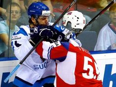 (The hockey player in blue did not punch the head off the hockey player in red.)