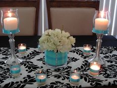 white flower centerpiece arrangement with the vase cover in Tiffany Blue fabric. Along with the tea lights...