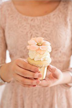 gold and pink cupcake with edible flower #bridalshower #weddingtreats #weddingchicks http://www.weddingchicks.com/2014/02/18/pink-and-blue-bridal-ask-party