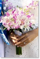 lavender and white orchid bouquet with matching leis visit us; http://www.weddings-kauai.com/