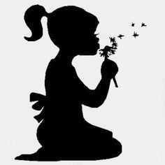 girl blowing dandelion silhouette