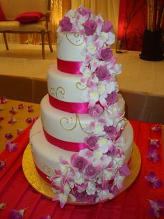 A new wedding trend is the use of fake wedding cakes. The faux wedding cakes commonly are made of Styrofoam. Guests are served cheaper sheet cake. Fake Wedding Cakes, Unusual Wedding Cakes, Indian Wedding Cakes, Wedding Cake Fresh Flowers, Pretty Wedding Cakes, Wedding Cake Decorations, Elegant Wedding Cakes, Beautiful Wedding Cakes, Wedding Cake Designs