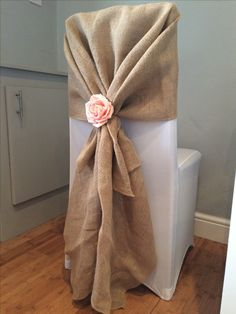 Chair cover with hessian hood and pink Rose accessory. Hire from affinity event decorators in South Wales