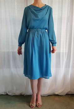 Check out this item in my Etsy shop https://www.etsy.com/uk/listing/490590552/blue-vintage-1960s-dress-with-silver