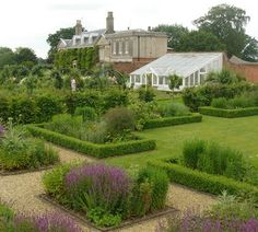A family garden for a country house in Norfolk. This large walled garden was laid down to grass. A swimming pool and tennis court at one end were separated from the rest of the garden by tumbledown fencing. While it was important to stay true to the garden's origins as a vegetable garden, four acres of vegetables were not going to be needed by the owners. Instead we have combined vegetables and flowers to create a magical contemporary garden that retains its strong sense of place. (Arne…