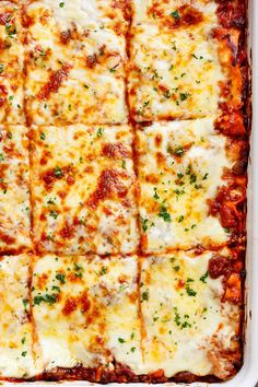 The Best Lasagna is here! Layered with a rich meat sauce and a creamy parmesan white sauce, plus the perfect amount of mozzarella cheese! NO ricotta cheese needed! | cafedelites.com