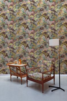 An amazing wallpaper featuring a painterly image of flowers and grasses in an all over pattern. Created in four seasonal colourways. This is Spring with shades of yellow, pink and green.
