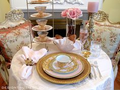 Elegant Byzantine Tea: A pink depression glass dessert set is presented on the plate stand. French Aubusson pillows add comfort and a touch of color to the scene. The tablecloth is vintage blush damask.