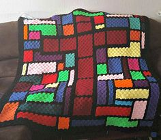 This Stained Glass Cross Afghan crochet pattern is a wonderful project to use up some leftover yarn, so many gorgeous color options.What you need for the Stained Glass Cross afghan: Scrap Yarn Crochet, C2c Crochet Blanket, Crochet Quilt, Free Crochet, Crochet Afghans, Crochet Ripple, Afghan Crochet Patterns, Quilt Patterns, Crotchet Patterns