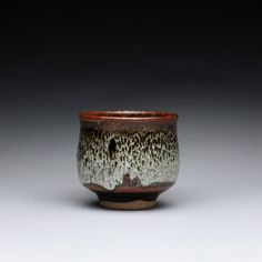 espresso cup - teacup - sake cup with black brown tenmoku and wood ash glazes.  via Etsy. R Morales