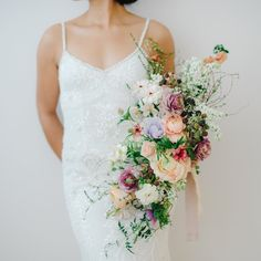 A beautifully detailed gown with a bouquet to match. (link in bio to shop the Naomi Gown | #regram @pear.street.flowers : @amanda_dumouchelle @passionflowersue)