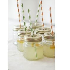 """This fantastic set boasts a dozen drinking mason jars with daisy metal lids and colorful eco straws. Whether it's outdoor parties, kid's fetes or a snazzy holiday soiree you can serve up just about any drink with some seriously fun style!  Each jar and lid measures 3.5 x 3"""" (8.9 x 7.6 cm). Straws measure 7.75"""" long (19.7 cm).  Giftset includes 12 Jars, 12 lids, and 12 paper straws."""