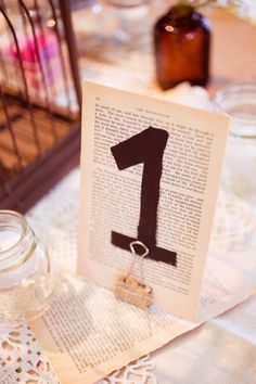 Cute way to display table #'s.    Photography by halforangephotography.com, Floral Design by petalpushers.us