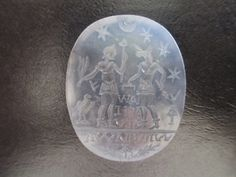 A very large Gnostic agate intaglio.  A Roman soldier (identified by the legionary eagle) faces  Anubis (representing Egypt), standing on level field. Texts appear to be Latin below the figures, with Aramaic characters in the field behind.  Each figure holds attributes of position and status.  Apparently representing the union of Egypt to Roma. Four significant stars and a crescent moon above. Circa 1st century BC/AD -  Private U.S.A. collection.