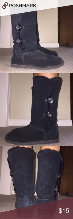 UGG Style Boots Black UGG style boots. Only flaw is on left boot toe part (I stepped on a hot piece of something by a fire and it melted it just a tad but it's not noticeable unless you point it out). Otherwise great condition! Faux fur Lined and around the top of boot. Keep your tootsies warm for the cooler days! 2 buttons on the outside of boot. Xhilaration Shoes Winter & Rain Boots