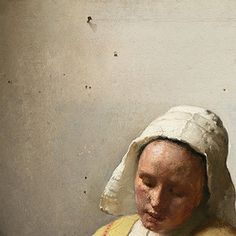 Johannes Vermeer, The Milkmaid, 1657-58. There is another area showing the mastery of Vermeer's handling of the painting technique. The most prominent is the natural rendering of the whitewashed wall in the background of the painting. Vermeer used a mixture of umber, black and lead white to render the feeling of texture and realism further underscored by numerous cracks, stains, nails and holes.