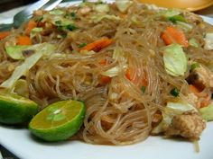 Pancit, or pansit, is a quick-cooked noodle dish that is one of the quintessential meals of Filipino cuisine. The most common variety is pancit bihon, with rice vermicelli and a mix of meat and vegetables. Chicken Pancit Recipe, Pancit Bihon Recipe, Pansit Canton Recipe, Filipino Recipes, Asian Recipes, Ethnic Recipes, Filipino Dishes, Filipino Vegetable Recipes, Noodles