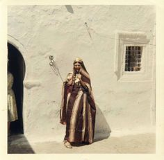 """An Old Picture of a Tunisian Woman in Traditional """"TAKHLILA"""" clothes"""