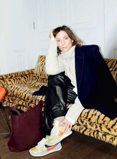 phoebe philo with epic bitchface, leather sweats, air maxes, leopard couch. PERFECT.