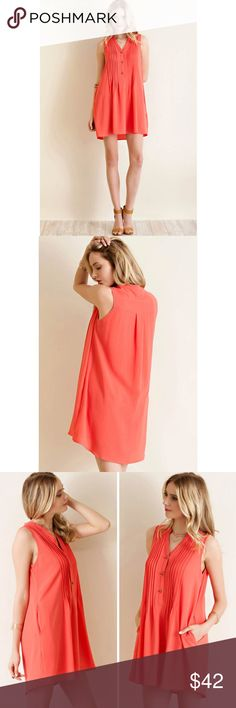 Pin Tuck Detailed Shirt Dress Solid crepe chiffon button down pun-tuck detailed shirt dress featuring pockets.  Color- Coral Entro Dresses Mini