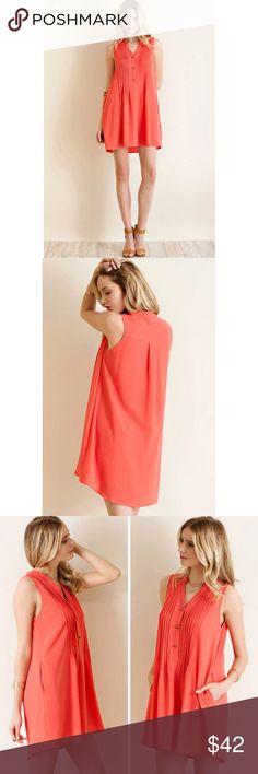 Pin Tuck Detailed Shirt Dress Solid crepe chiffon button down pun-tuck detailed shirt dress featuring pockets.  Color- Coral Entro Dresses Mini