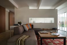 Here's another excellent example of light sharing between rooms.  In this case, between the kitchen and the family room.