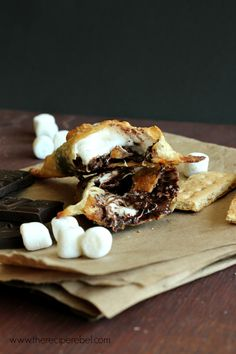 """educate yourself on """"slave chocolate"""" and the alternatives known as """"ethical chocolate"""", """"slave free chocolate""""! - Easy S'mores Hand Pies -- wonton wrappers make these hand pies SO easy! Only 5 ingredients! Just Desserts, Delicious Desserts, Dessert Recipes, Yummy Food, Dessert Ideas, Yummy Treats, Sweet Treats, The Recipe Rebel, Wonton Recipes"""