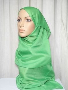 """Short length hijab to be worn under or upper hijab  Usage:    Eliminate hair of transparency upper hijab.  Concerting trim for head.  Different hijab wrap style.  Fabric: Blended Egyptian Cotton  Approximate Measure: 17.7' x 59"""" /45 x 150cm  Color:Green                Price: US$2.95  1.85 GBP 2.32 EUR 2.90 CAD"""