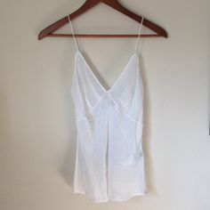 HP 7.31ROBERTO CAVALLI Camisole White Silk Top 100% Authentic ROBERTO CAVALLI UNDERWEAR Undershirt White Silk Top.  Reg.$299 NWT. Excellent Condition. Never Worn. Size: 42.   Silk 100%.  Comes from Smoke- Free and Pet- Free home. Made in Italy. As 11.16 Roberto Cavalli Tops Camisoles