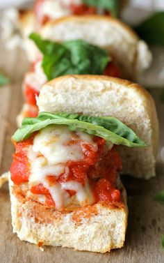 Italian Meatball Sliders - Melted mozzarella and savory meatballs are nestled within a fluffy water roll. Click this pin to get the recipe on the blog!