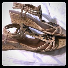 Never worn adorable wedge sandals! MAKE AN OFFER These cute sandals have been sitting in my closet, they need to be worn! They have gorgeous flower details on the front, and are in amazing condition. Never worn! DSW Shoes Sandals