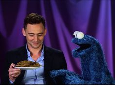 Cookie Monster Learns a Lesson from Tom Hiddleston One of my fav characters from Sesame Street, and a nickname of mine Cookie. And one of my favorite villains Tom Hiddleston(Loki) I Smile, Make Me Smile, Fraggle Rock, Dc Movies, Thing 1, Tom Hiddleston Loki, Geek Out, The Villain, Cookie Monster