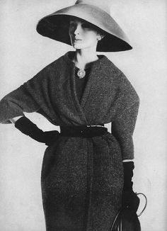 September Vogue 1959    Wearing a grey worsted coat with a patent leather belt, by Nina Ricci. Photographed by Irving Penn.