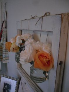 One of my pinterest ideas put to use...old frame + mason jars + flowers from Holli's wedding = pretty pretty!