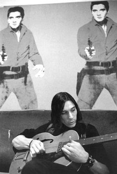 John Cale with Andy Warhol's Elvis at the Factory. Photographer: Stephen Shore.