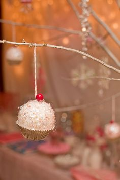 Homemade sparkly cupcake ornament.