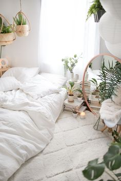 White Bedroom Design by: Poli Twins @caitpoli & @delaneypoli of Poli Productions. Collaboration with Urban Outfitters. #UOHome #UrbanOutfitters #InteriorDesign #HomeStyling #Bedroom #BedroomGoals #RoomDecor #BedroomDecor #Boho #BohoChic #HousePlants #Plants #WhiteBedroom #Minimal #MinimalBedroom #Palms #Modern