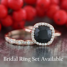 This cushion engagement ring is crafted in solid 14k rose gold with a 8x8mm cushion cut natural black spinel surrounded by sparkling conflict free